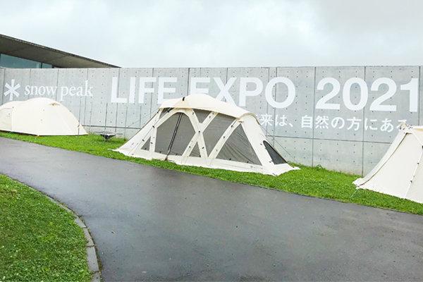 屋外開催の総合展示イベントにおいてゲストの位置測位とトークショー用映像伝送を同時に実現